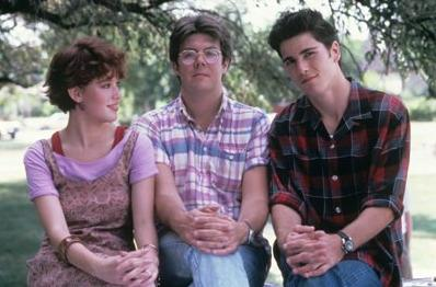 John Hughes on the set of 'Sixteen Candles' with Molly Ringwald and Michael Schoeffling